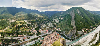 View on town Entrevaux, France. Mountains and blue river. Stock Photo