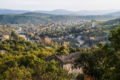 View of the town of Ganges, France. View of the town of Ganges and River Herault, France royalty free stock photo