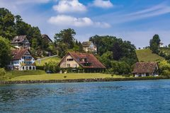 Town Hertenstein on Lucerne lake Royalty Free Stock Image