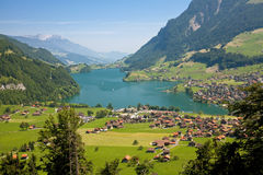 View on a town on a lake. Landscape with a mountain lake and its town stock photography