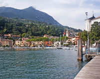 View on a town on lake Garda and the Alpes. View on the town on lake Garda, the Alpes mountains, Italy Royalty Free Stock Images