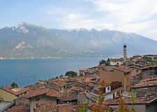 View on a town on lake Garda and the Alpes. View on the town on lake Garda, the Alpes mountains, Italy Royalty Free Stock Photo