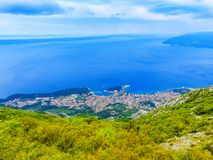 View of town Makarska in Croatia from mountain Biokovo. View of town Makarska in Croatia at sunset from mountain Biokovo, in the background are islands Hvar and Royalty Free Stock Images