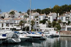 View of town and marina, Marina del Este, Spain. Boats moored in the marina, Marina del Este, Costa del Sol, Granada, Province, Andalusia, Western Europe Stock Photo