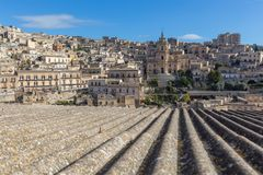 View of the town of Modica with the San Giorgio cathedral. View of the town of Modica with the imposing San Giorgio cathedral and staircase surrounded by gardens Stock Photo