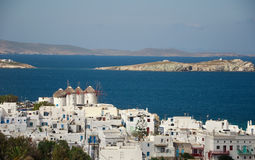 View of the town of Mykonos and windmills Stock Photos