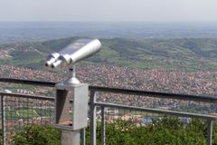 View of the town from observation deck. With tourist binocular on the top of mountain Bukulja in Arandjelovac, Serbia Stock Image