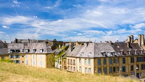 View of town from rampart of Chateau de Sedan. SEDAN, FRANCE - JUNE 30, 2010: view of town from rampart of castle Chateau de Sedan in summer day. Sedan is a Royalty Free Stock Image