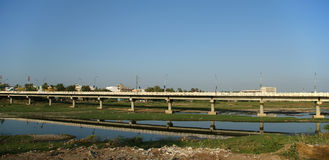 View of town from the river dried up and the bridge, South India, Kerala, Madurai Stock Photos
