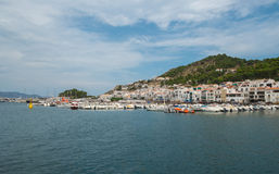 View of the town in Spain through sea. Royalty Free Stock Photo