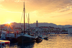 View on town Split and on boats in its harbor at sunrise from  - Dalmatia, Croatia Stock Photo
