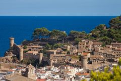 View of the town of Tossa de mar one of the most beautiful towns. On the Costa Brava. City walls and medieval castle on the hill. Amazing city in Girona stock images