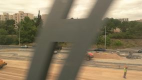 View of town from train. Road construction at daytime. New plan of rebuilding roads stock video