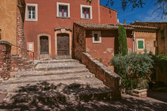View of traditional colorful house in ocher and staircase, in Roussillon.