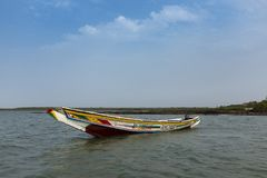 View of a traditional fishing canoe near the island of Orango, in Guinea Bissau. Orango is part of the Bijagos Archipelago;. Orango Island, Guinea-Bissau royalty free stock image