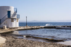 View of traditional fishing village of Empoureio at Milos island in Greece Royalty Free Stock Photo