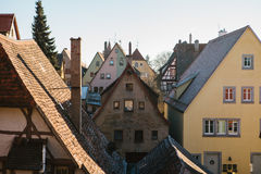 A view of the traditional German houses and roofs in Rothenburg ob der Tauber in Germany. European city. Stock Images
