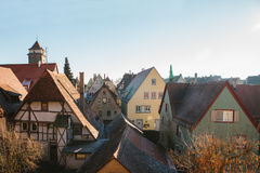 A view of the traditional German houses and roofs in Rothenburg ob der Tauber in Germany. European city. Stock Photos