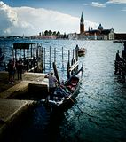 Gondola in Venice, Italy. View of a traditional gondola boat and the Giudecca backround royalty free stock photos