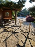 Traditional Japanese style garden. A view of a traditional Japanese stone garden with a gazebo lit by afternoon sun Stock Photos