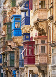 A view of the traditional maltese balconies, Valletta. A view of the traditional varicoloured maltese balconies of the St. Paul`s street, Valletta Stock Photos