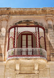 A view of traditional Maltese style balconies in Mdina. Malta. A traditional Maltese style openwork balconies on one of the residential houses of Mdina. Malta Royalty Free Stock Photo