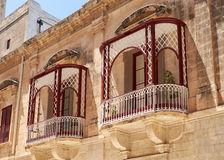 A view of traditional Maltese style balconies in Mdina. Malta. A traditional Maltese style openwork balconies on one of the residential houses of Mdina. Malta Royalty Free Stock Images