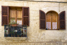 A view of traditional Maltese style balcony and window in Vallet. A traditional Maltese style window and open balcony on one of the residential houses of Stock Photography