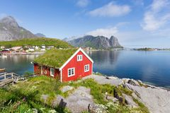 View of traditional norwegian red hut in Lofoten islands. Beautiful summer day and blue sky. stock photography