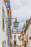 View of a traditional street lamp, Portuguese vernacular buildings on medieval village inside the fortress and Luso Roman castle. Obidos / Leiria / Portugal - 04 stock image
