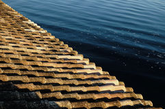 View from traditional tiles rooftop to calm sea waters Stock Photography