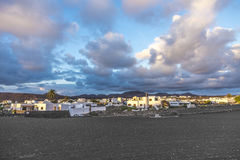 View on traditional whitewashed village with volcanos on the bac Royalty Free Stock Photography