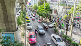 View of Traffic jams under BTS Asok. Bangkok, Thailand - JUNE 6 : View of Traffic jams under BTS Asoke Sky train railway June 6, 2015 in Bangkok Royalty Free Stock Images
