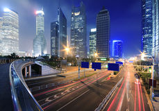 View traffic through modern city at night in shanghai. View traffic through modern landmark buildings background city at night in shanghai Stock Photo