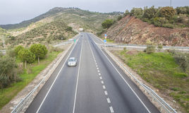 View of traffic at national road with slow vehicles lane. Cerro Muriano, Cordoba Royalty Free Stock Images