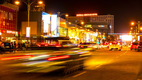 View of the traffic at niche in the city. MELAKA, MALAYSIA - MARCH 23: Time-lapse view of people pass by at night in the city on March 23, 2016 in Melaka Stock Image
