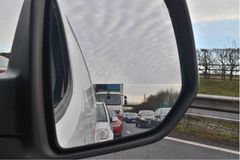 View of traffic from rear view mirror Royalty Free Stock Photos