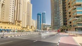A view of traffic on the street at Jumeirah Beach Residence and Dubai marina timelapse hyperlapse, United Arab Emirates. Traffic on the street at Jumeirah Beach stock footage