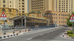 A view of traffic on the street at Jumeirah Beach Residence and Dubai marina timelapse, United Arab Emirates. Tram moves near tram stop. JBR is the largest stock video footage