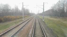 View from the train cabin to the railway stock footage