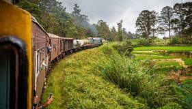 View of train and carriages taking bend on classic Nanu Oya to Ella railway trip in Sri Lanka. On 24 September 2016 royalty free stock photo