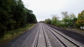 The View from a Train Crosses a Level Crossing. The view from a train as it travels through New York State and crosses a level crossing hd, 25fps stock footage