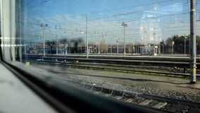View of train departing from Florence. Main station stock footage