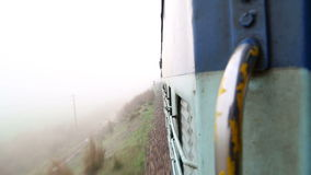 View on train during a ride from the train door. JODHPUR, INDIA - 13 FEBRUARY 2015: View on train during a ride from the train door stock video