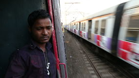 View on train speeding up from another train passing by. stock footage