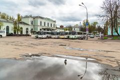 View of Train Station with buses on the square waiting passengers in Pskov, Russia. Pskov, Russian Federation - May 5, 2018: View of Train Station with buses on Stock Photos