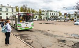View of Train Station with buses on the square waiting passengers in Pskov, Russia. Pskov, Russian Federation - May 5, 2018: View of Train Station with buses on Stock Image