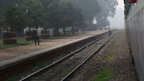 View on train station and people from moving train. stock video footage