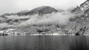 Fog in the Swiss Alps. A view from the train of the Swiss Alps on a wintery day Royalty Free Stock Images