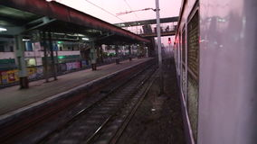 View from train to railway station during ride. stock footage